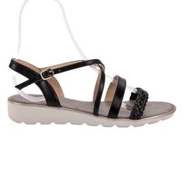 Kylie Musta sandaalit alustalla