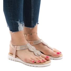 Pinkki Vaaleanpunaiset sandaalit, jotka on koristeltu S11: llä